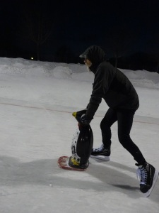 Me pushing a penguin around on the ice rink