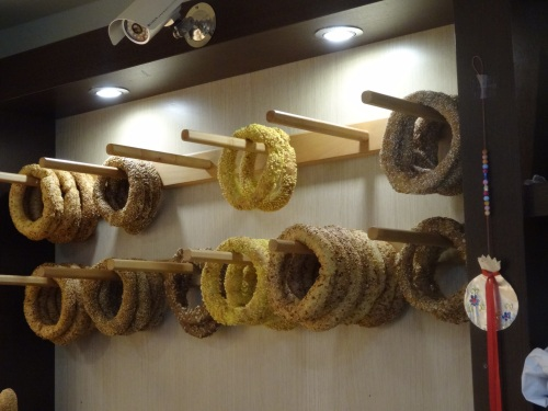 Koulouri of various kinds, displayed in a bakery.